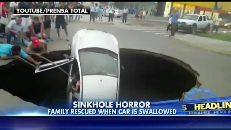 A family is rescued from a sinkhole that swallowed their car.