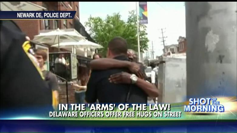 Watch What Happens When Two Cops Offer People 'Free Hugs'