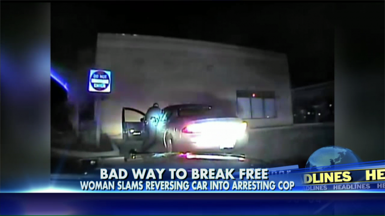 A woman in Michigan slams her reversing car into a police officer.