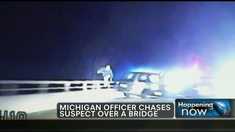 VIDEO: Michigan Police Officer Chases Suspect Off 25-Foot Bridge