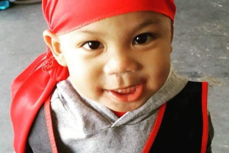 Two rival gang members were charged with murder after a 3-year-old Franklin Ponros died during a shootout inside a liquor store in Compton in January.