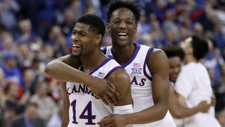 Malik Newman, left and Marcus Garrett celebrate after Kansas defeated Duke 85-81 in overtime in the NCAA Midwest Regional Final in Omaha, Neb. Sunday. (AP Photo/Nati Harnik)