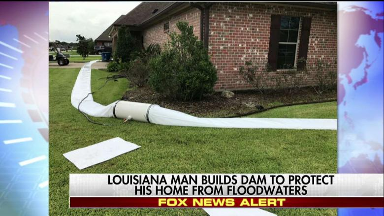 LOOK: A Man Made His Own Dam to Save Home From Harvey ...