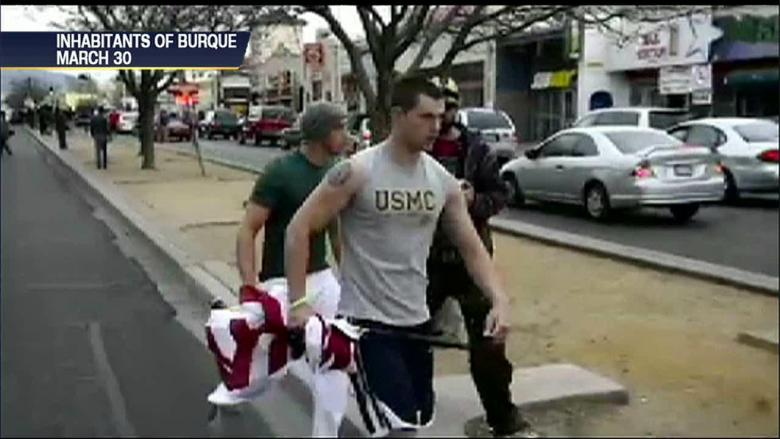 VIDEO: Military Men Chase Down Protesters Flying Upside-Down American Flag  | Fox News Insider